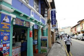 WHERE IT HAPPENED: The blue-painted second-storey shophouse at 103, Dunlop Street, was where three businessmen were robbed in 2012.