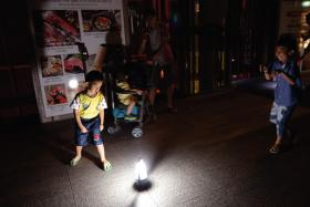 Children playing around a light on the seventh floor of Orchard Central