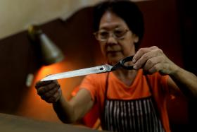 Madam Lee Hwee Chin, 68, is one of the last knife sharpeners around.