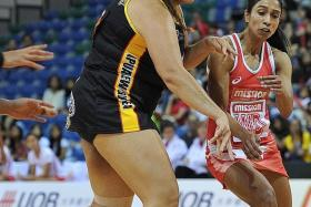 CLOSE CONTEST: Singapore's Premila Hirubalan (in red) fighting for the ball with Tiata Baldwin.