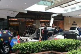 DEBRIS: Four people were sent to hospital after part of the hotel driveway ceiling came tumbling down.