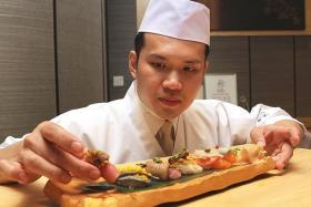 SKILL: Mr Damien Tan shows six of the 20 sushi pieces he made during the contest.