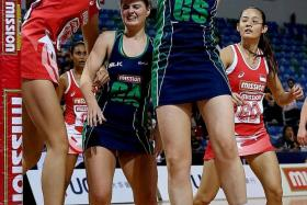 TOUGH DAY: Singapore's Chen Lili (left) just could not find a way past the bigger Northern Irish girls (in blue and green).