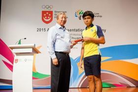 SPAIN BOUND: Singapore Olympic Foundation chairman Ng Ser Miang (above, left) with young footballer Muhd Zamanuriki Mohd Zamnuri.