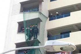 RELIEVED: SCDF officers deployed safety gear and pulled a man on the ledge to safety (above).