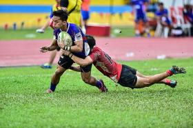 COMPETITIVE: The Asian Rugby Under-19 Championship match between Singapore (in red) and Taiwan (in blue) nearly ended in a free-for-all.