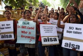 Indian students protest against recent rapes in New Delhi outside of the Indian capital's police headquarters in October.