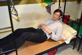 A picture of Mr Teo Ser Luck, Mister of State for Manpower lying down on a foreign worker's bed that was upload on MOM's Facebook page. 