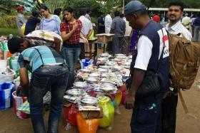 FLOOD RELIEF: Volunteers prepare relief packs that include towels, mosquito nets, blankets and bread.