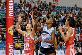 FINDING THE NET: Charmaine Soh (left) scores in Singapore's loss to Botswana on Wednesday.