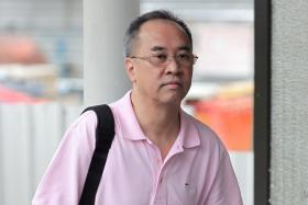 In a file photo, Koh Yong Chiah arrives at the State Courts on July 17, 2014.