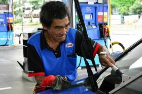 JOB: Mr Tan Soy Kiang working at a Esso petrol station in Toa Payoh.