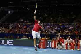 TEAMWORK: Stan Wawrinka (above) cited his OUE Singapore Slammers teammates' energy from the bench as a factor in his come-from-behind win over Bernard Tomic.