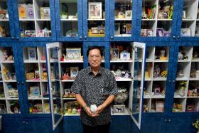 Mr Patrick Lim, 63, at the Pets Cremation Centre columbarium.