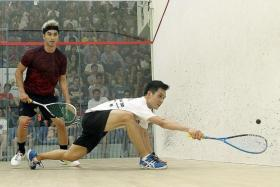 EXPERIENCE TRIUMPHS: Malaysia's Ong Beng Hee (in white) seeing off compatriot Valentino Bong in the Men's Premier final of the Old Chang Kee Singapore Open yesterday.