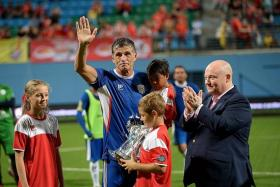 NOT GOODBYE: Aleksandar Duric (waving) is in Melbourne to help daughter Isabella Nina (left) find a school.