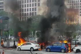 BURN: The fire left several cars badly burned.