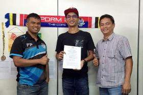 DONE DEAL: Malaysian club PDRM FA posted on their social media platforms a photo of national footballer Safuwan Baharudin holding what appears to be a contract.