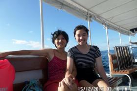 NATURE LOVER: Vivian Yap with her mother, Madam Nicole Tsai (above), and with a dive master during a diving trip two days before the tragedy.