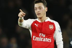 I've always admired (Zinedine) Zidane. He didn't do tricks for the sake of it. He never wanted to show off. He just played a clever game. He's the player who decides games. I've watched his technique and tried to do that in my game and, a lot of times, it worked. — Arsenal ace Mesut Oezil (above)