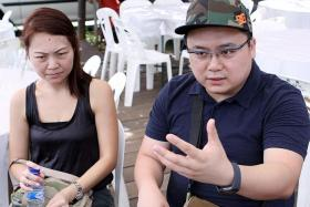 GRIEVING: Madam Claire Ng (left) and her husband Darius Liew at the Lims' wake in Sin Ming Drive yesterday. Madam Ng's sister, brother-in-law and nephew died in the crash.
