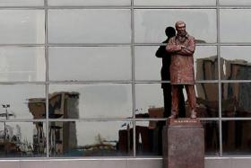 IMPOSING: Sir Alex Ferguson's statue (above) at Old Trafford continues to cast a long shadow on the managers picked to succeed him.