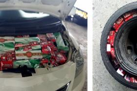 Contraband cigarettes found in the bonnet and spare tyre.