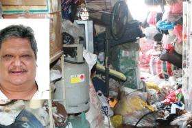 Mr Tan Ban Huat's cluttered flat at Block 4 Marsiling Road. Mr Tan turned violent and slashed two neighbours on 26 January 2015. Shortly after the attacks, he was found dead inside his burning unit on the eighth-storey.