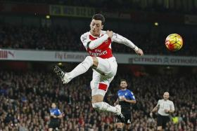 ON TRACK: Mesut Oezil, with 16 assists, is closing in on Cesc Fabregas' personal record of 18 assists, set last season with Chelsea.