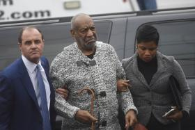 Actor and comedian Bill Cosby arrives with attorney Monique Pressley (right) for his arraignment on sexual assault charges at the Montgomery County Courthouse in Pennsylvania.