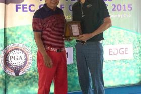 CHAMP, FINALLY: Quincy Quek (left) is all smiles after receiving the winner's trophy from Tering Bay boss Morgan Tan for he breaks a 20-month title drought.