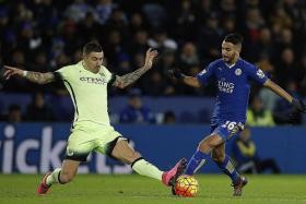 FACE-OFF: City's Aleksandar Kolarov (left) and Leicester's Riyad Mahrez.
