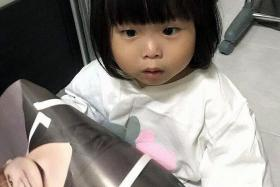FOUND: Two-year-old Angie Tiong, who has been missing for more than a month, was surrendered to Johor police yesterday.