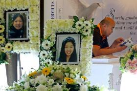 TRAGIC: (Above) Mr Stephen Yap at his daughter Vivian's wake on Wednesday night. He had requested for a picture of his ex-wife, Madam Nicole Tsai, to be placed next to Vivian's picture.
