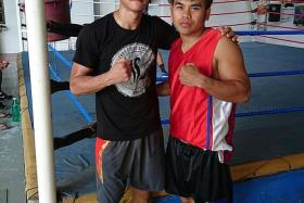 ALL SET: Singapore boxer Ridhwan Ahmad (left) poses for a photo with his trainer, former professional Rey Caitom (right), at the ALA Gym in Cebu, Philippines. Ridhwan aced his two trial fights and earned himself a spot on the undercard of Pinoy Pride 35 - Philippines' biggest boxing event - on Feb 27.