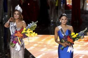 SHAME: Miss Colombia, Ariadna Gutierrez (left) with her crown beside Miss Philippines before the host announced his mistake.
