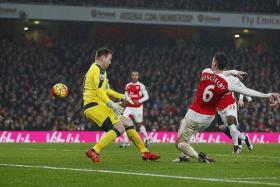 CUTTING EDGE: Laurent Koscielny (No. 6) scores the winner to give the Gunners sole posession of top spot.