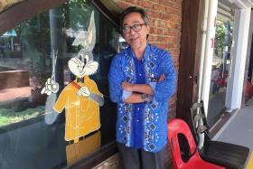 MR BUGS BUNNY BARBER: Mr Abdul Kadir Samin outside his shop Bugs Bunny Barber.