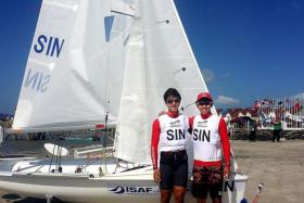 ALL SMILES: Sailors Matthew Lau (left) and Loh Jia Yi, in Langkawi, Malaysia for the Isaf World Youth Sailing Championships, which ended yesterday.