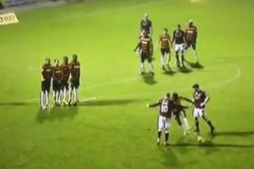 Barnet defender Gavin Hoyte attempts to prevent Northampton from executing their free-kick routine.
