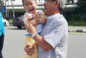 HAPPY: Angie Tiong, who now sports a crew cut, is being carried by Mr Yap Yeen Min.