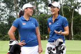 Singapore golfers Amelia Yong (left) and Koh Sock Hwee in a 2012 file photo.
