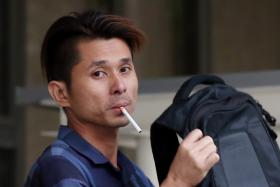 Justin Chew Chee Kin leaving the State Courts after putting up bail in October, 2015.
