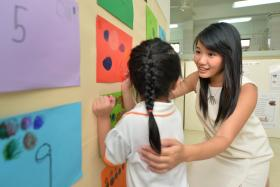 NATURAL: Miss Vienn Han (right) blossomed after joining Temasek Poly's Early Childhood Studies diploma course.