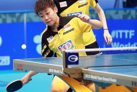 DYNAMIC DUO: Junior players Lin Ye (above) and Zhou Yihan beat Feng Tianwei and Yu Mengyu in the SEA Games women's doubles.