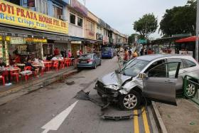 AFTERMATH: A car hit the railing near the Roti Prata House at Upper Thomson Road last Sunday. Parts of the railing landed close to customers sitting outside the eatery, raising questions about the potential danger of these projectiles.