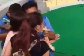 A screen capture of the video which shows the unnamed Chinese tourists getting bitten in the face at a snake show in Thailand.
