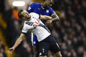 ATTENTION: Leicester captain Wes Morgan (in blue) keeping Spurs' Harry Kane quiet throughout the match.