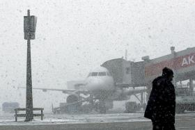HEAVY SNOW: Flights out of Turkey from Ataturk International Airport in Istanbul were delayed due to the weather on New Year's Eve.
