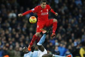 STEP UP: Roberto Firmino (above, jumping over Manchester City's Eliaquim Mangala) is a man for big matches, like when he helped Liverpool to a 4-1 win over City in November.